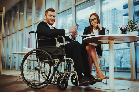 Healthcare of Business People. Office Worker doing Fitness Exercises. Happy Office Manager. Workers in Suit. Time Management. Man Disabled on Wheelchair at Work. Office Interior. Task Book