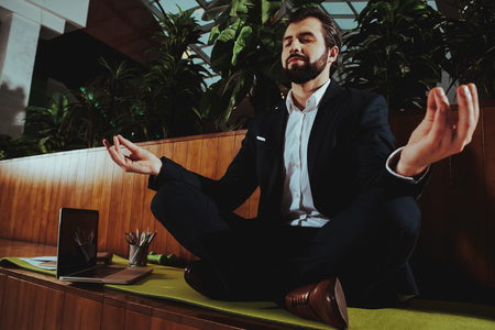 Sport Lifestyle. Healthcare of Business People.Yoga Practice. Employee Practicing on Bench in Office. Worker Sit in Lotus Pose. Man is Meditating. Person Relax. Male Keeps Calm. Zen Time.