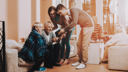 Man and Woman Watch Something on Tablet. Nursing Home. Senior Couple Hold Lees of Life. Young People Visit Older. Sear and Yellow Leaf. Meeting with Grandchildren. Grandchildren Hold Laptop.