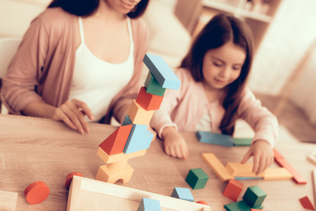 Mother Teaches Daughter. Educational Games. Learning Child at Home. Cost House of Cubes. Cubes and Puzzles. Child Development. Board Games for Children. Modern Learning for Children. Play Cubes.