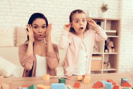 Play and Make Grimaces. Woman and Girl Play. Educational Games. Learning Child at Home. Happy Mom and Daughter. Cubes on Table. Child Development. Childrens Board Games. Modern Learning for Children. Stok Fotoğraf