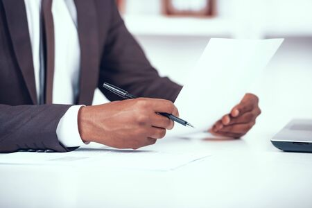 Cropped African Businessman Holding Document.