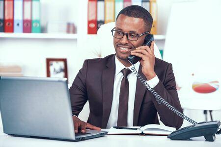 African American Man Has Business Call in Office. Standard-Bild