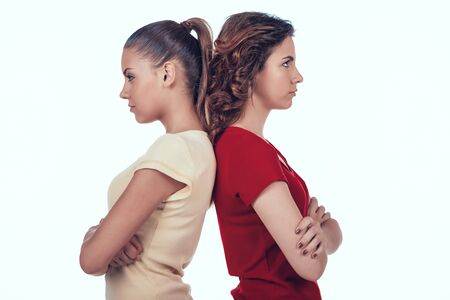 Jealous Women Standing with Backs to Each Other.