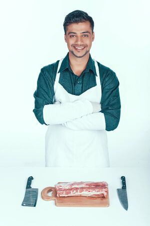 Handsome Butcher in Apron Going to Cut Meat.