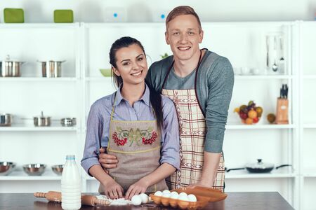 Happy Couple Making Domestic Pastry at Kitchen.