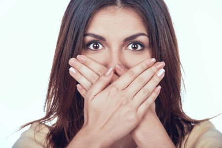 Woman Covers Mouth Social Pressure and Censorship.