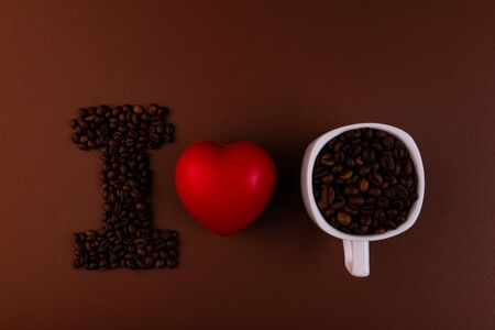 Red heart, white cup and grains of coffee. I LIVE YOU Concept