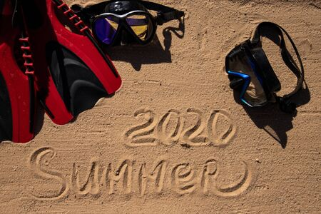 The inscription on the yellow sand SUMMER 2020