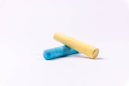 Blue and yellow chalks on a white background. Education. Archivio Fotografico