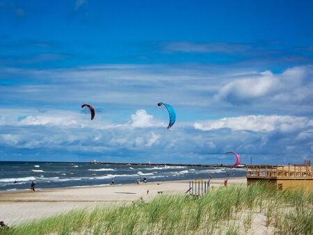 Kiteboarders in the Baltic Sea on Ventspils Beach in Latvia