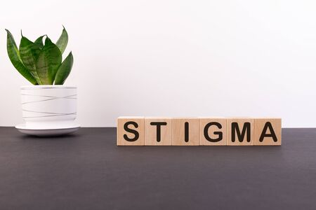 STIGMA word made with building blocks on a light background Фото со стока