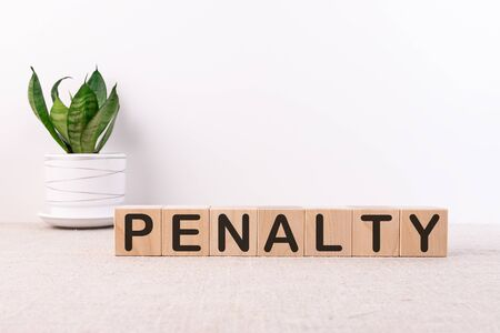 PENALTY word made with building blocks on a light background Foto de archivo