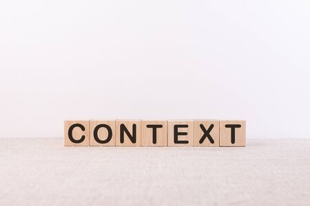 CONTEXT word from building blocks on a light background and table Stock Photo
