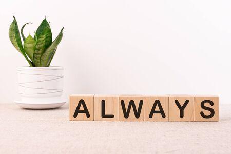 ALWAYS word on wooden cubes on a light background 版權商用圖片