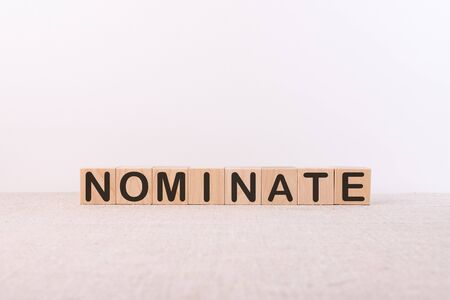 NOMINATE word made from building blocks on a white background 스톡 콘텐츠