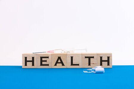 HEALTH inscription on cubes on a blue background