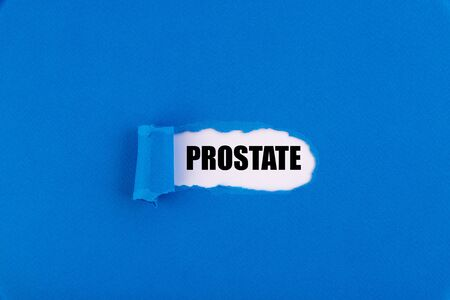 The text Prostate appearing behind torn blue paper.