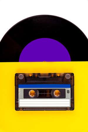 Vinyl record and audio cassette. Retro audio media.