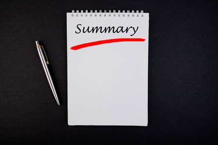 The inscription Summary concept in a notebook with a pen top view