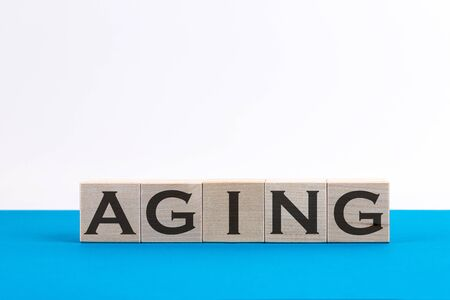 Word Aging made with wood building blocks