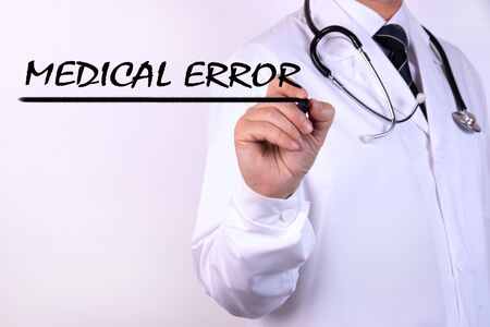 Doctor writing word Medical Error with marker Medical concept Stock fotó