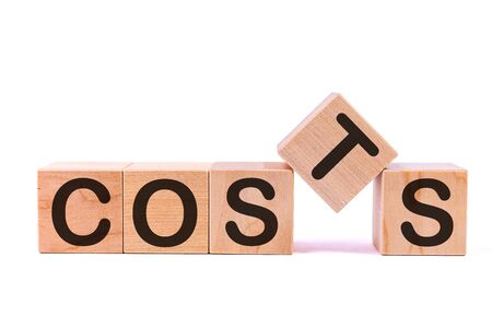 COSTS word made with building blocks isolated on white