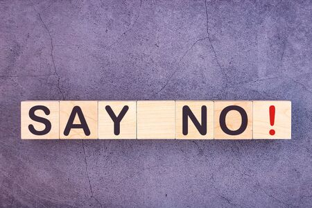 SAY NO word written on wood block on a grey background Stock fotó