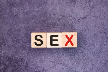 SEX word made with wood building blocks Stock Photo