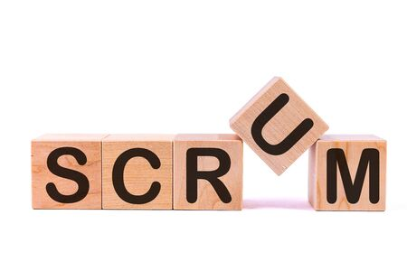 SCRUM word concept written on a light table and light background