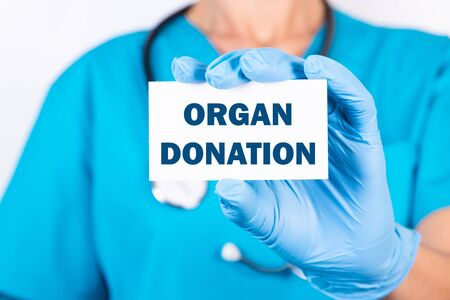 Doctor holding a card with text Organ donation medical concept