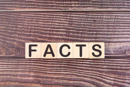 FACTS word made with wood building blocks Stock Photo
