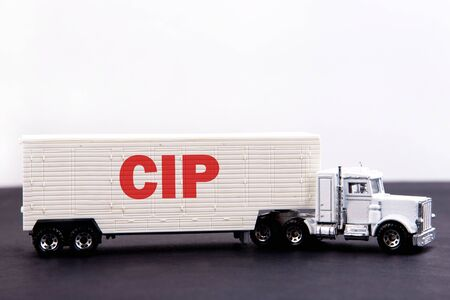 CIP word concept written on board a lorry trailer on a dark table and light background