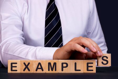 Man made word EXAMPLES with wood blocks