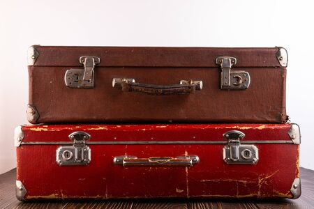 Vintage suitcases lie on a table on a light background.
