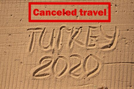 The inscription Canceled travel on the background of the marine concept TURKEY 2020.