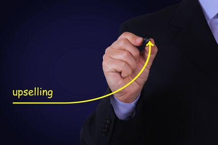 Businessman draw growing line symbolize growing Upselling