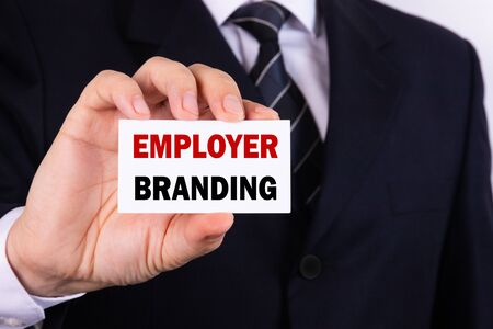Businessman holding a card with text employer branding