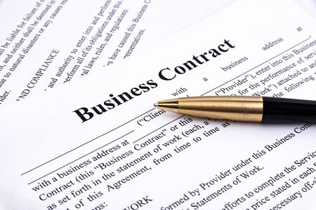 The pen lies on the contract. Business relationship concept.