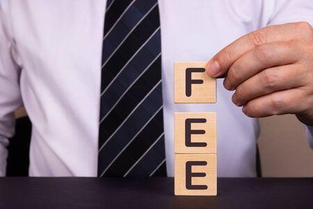Man made word FEE with wood blocks