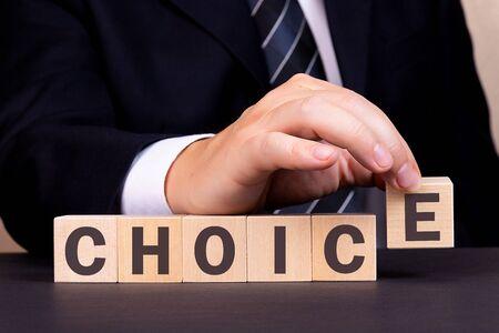 Man made word CHOICE with wood blocks
