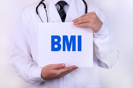 Doctor holding a card with BMI medical concept