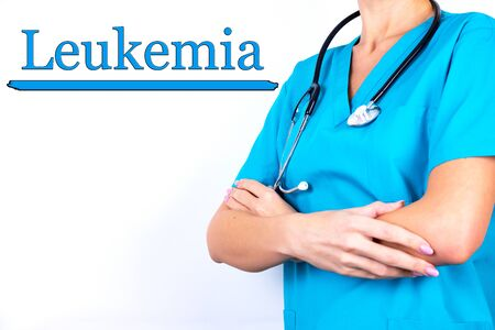 Doctor in medical clothes on a light background with the text Leukemia. Medical concept.