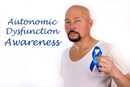 Inscription Autonomic Dysfunction Neuropathy on a white background and a nan with a symbolic blue ribbon.
