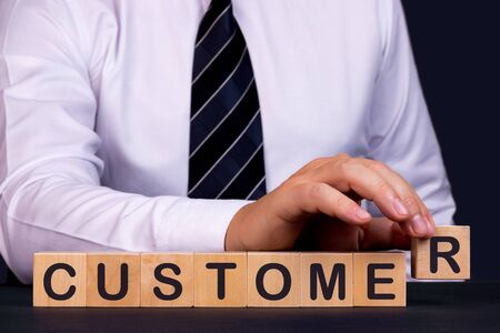 Man made word text Customer with wood blocks. Concept. Banco de Imagens