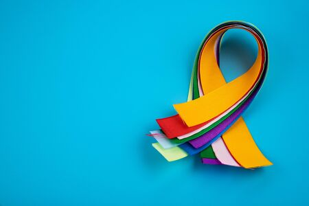 World Cancer Day February 4th. Multi-colored ribbons, symbols of the disease. Medical concept. The symbol of the struggle.