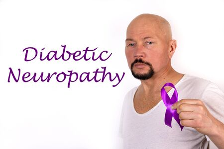 Diabetic neuropathy word, medical term word with medical concepts on white background. Purple ribbon as a sign of awareness in a man s hand.