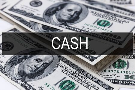 Background of dollar bills with word CASH Stock Photo