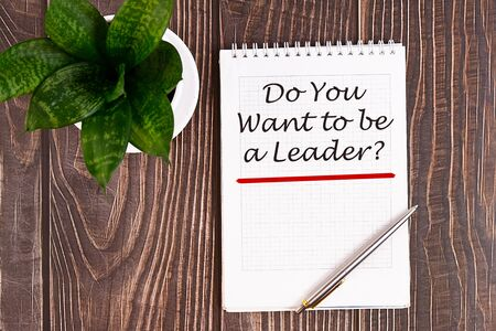Do You Want to be a Leader - handwriting on a notebook with pen and a cup of coffee Stock Photo
