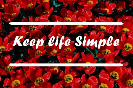 Inspirational Typographic Quote - Keep Life Simple with flowers in background